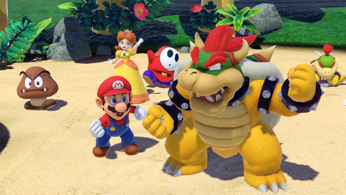 Ilustração de Super Mario Party mostrando o protagonista, antagonista e coadjuvantes festejando em uma praia