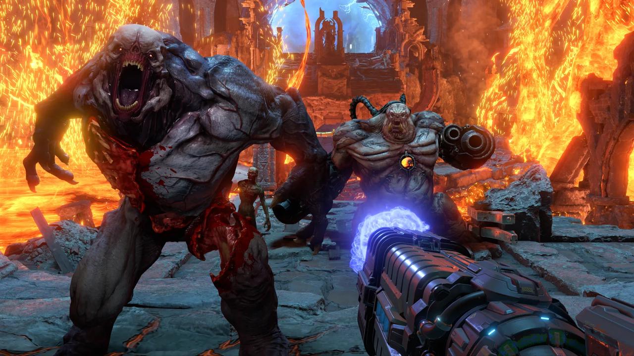 Dois monstros de Doom Eternal atacam jogador
